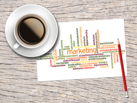 word clouds: Coffee, Pencil And A Note Contain Word Clouds Of Marketing And Its Related Words.