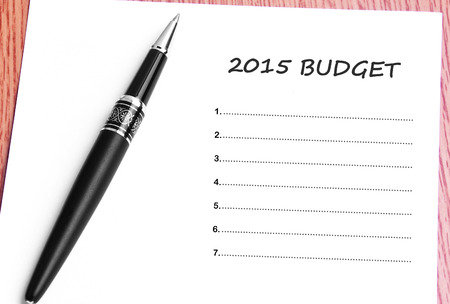 14 15 years: Pen  and notes paper with  2015 budget list. Stock Photo