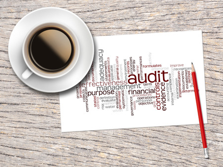 seeks: Coffee, Pencil And A Note Contain Word Clouds Of Audit And Its Related Words.