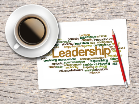powerful creativity: Coffee, Pencil And A Note Contain Word Clouds Of Leadership And Its Related Words. Stock Photo