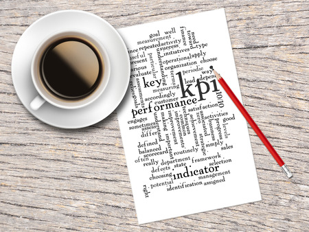 word clouds: Coffee, Pencil And A Note Contain Word Clouds Of KPI And Its Related Words. Stock Photo