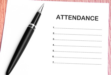 attendance: Pen  and notes paper with attendance list. Stock Photo