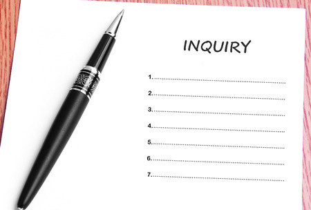 inquiry: Pen  and notes paper with inquiry list.