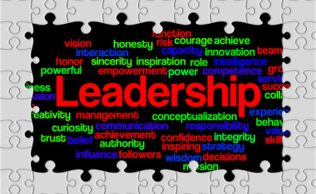 reveal: Jigsaw puzzle reveal wordcloud of Leadership and its related words. Stock Photo