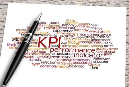 implement: Close Up Pen And Kpi Word Cloud. Stock Photo