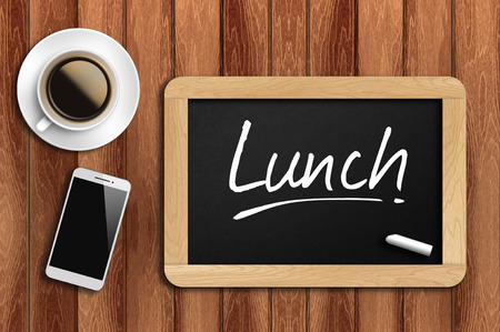 office time: coffee, phone  and chalkboard with  word lunch. Stock Photo