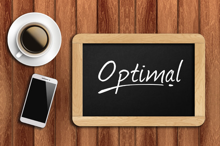 optimal: coffee, phone  and chalkboard with  word optimal.