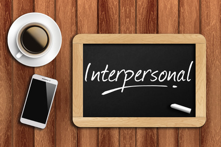interpersonal: coffee, phone  and chalkboard with  word interpersonal.