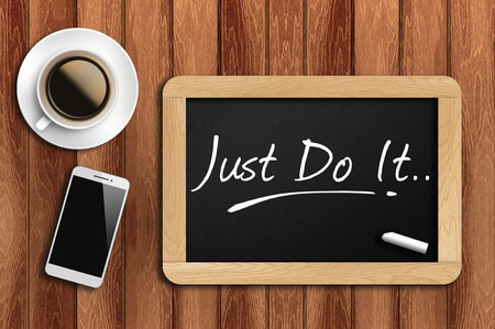 coffee, phone  and chalkboard with  word just do it. Archivio Fotografico