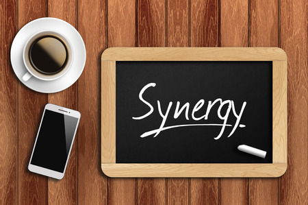 restaurant rating: coffee, phone  and chalkboard with  word synergy. Stock Photo
