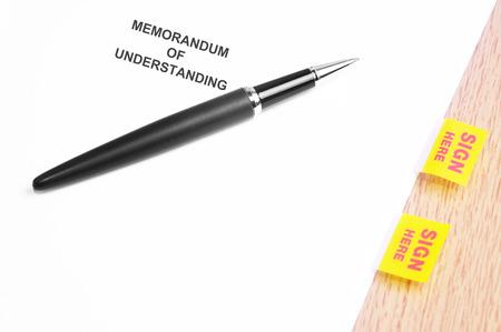 memorandum: Black Pen And Memorandum Of Understanding  With Sign Here Stickers.