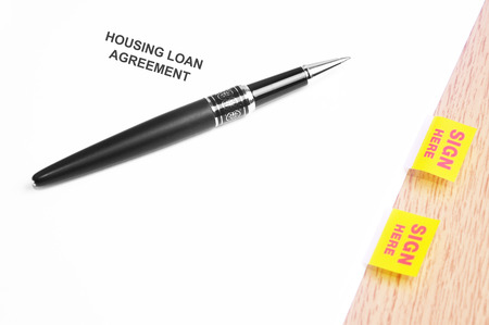 housing loan: Black Pen And Housing Loan Agreement With Sign Here Stickers. Stock Photo