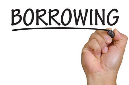 borrowing: hand writing borrowing Stock Photo