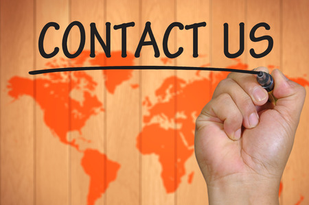 hand writing contact us  . Stock Photo