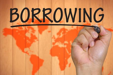 tomar prestado: escritura endeudamiento mano Foto de archivo