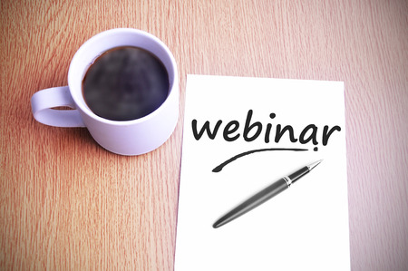 Coffee on the table with note writing webinar.