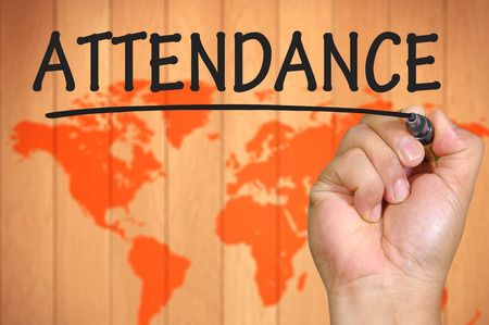 attendance: hand writing attendance . Stock Photo