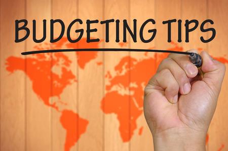 budgeting: hand writing budgeting tips Stock Photo
