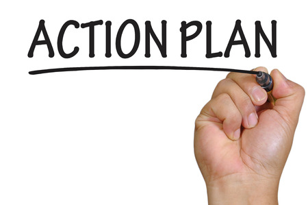 plan d action: �crit de la main de plan d'action. Banque d'images
