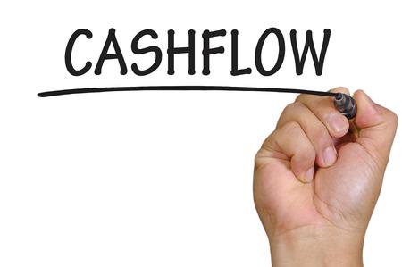 cashflow: flujo de caja de escritura a mano. Foto de archivo