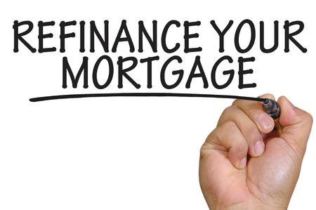 refinance: The hand writing refinance your mortgage Stock Photo