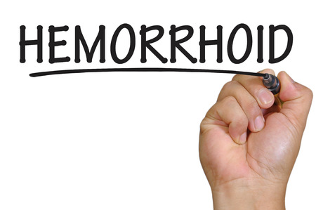 hemorrhoid: The hand writing Hemorrhoid Stock Photo