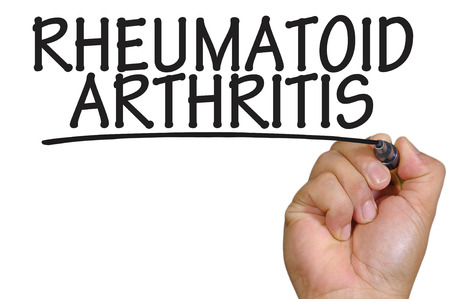 rheumatoid: The hand writing rheumatoid arthritis Stock Photo