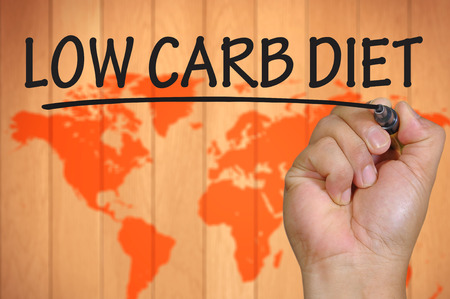 low carb diet: The hand writing low carb diet Stock Photo