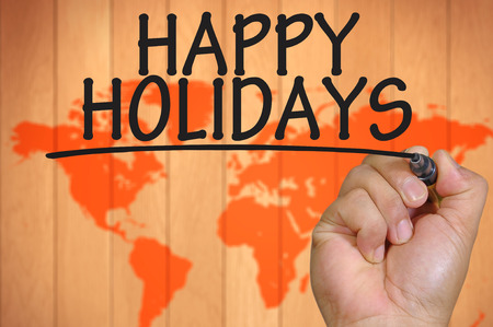 happy holidays: The hand writing happy holidays Stock Photo