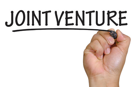 joint venture: The hand writing joint venture Stock Photo