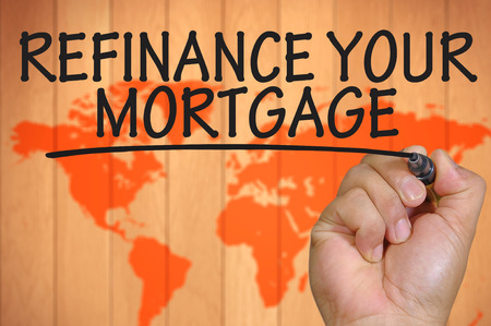 The hand writing refinance your mortgage Archivio Fotografico