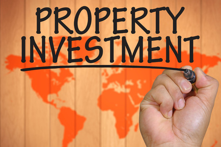 property investment: The hand writing property investment Stock Photo