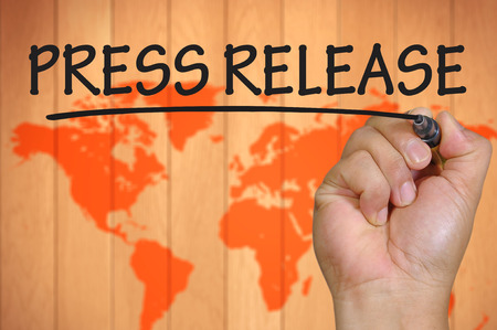 release: hand writing press release  . Stock Photo