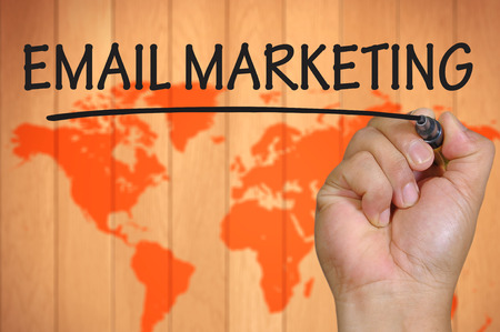 hand writing email marketing . Stock Photo