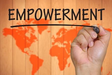 empowerment: hand writing empowerment . Stock Photo