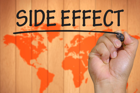 side effect: The hand writing side effect Stock Photo