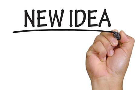 new idea: The hand writing new idea Stock Photo