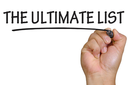 ultimate: The hand writing the ultimate list Stock Photo