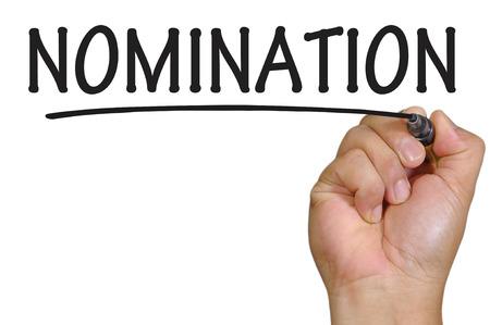 nomination: The hand writing nomination Stock Photo