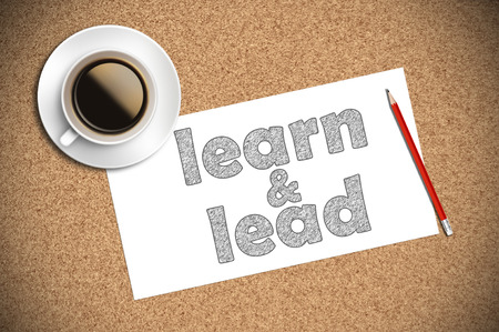 leading education: coffee and pencil sketch learn and lead on paper.
