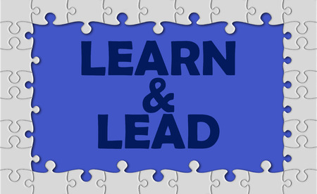 learn and lead: learn and lead with jigsaw border. Stock Photo