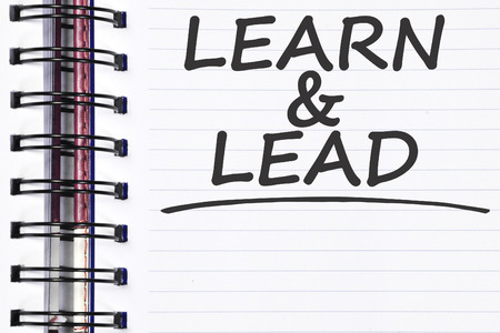 leading education: learn and lead words on spring note book.