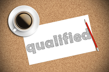 qualified: coffee and pencil sketch qualified on paper. Stock Photo