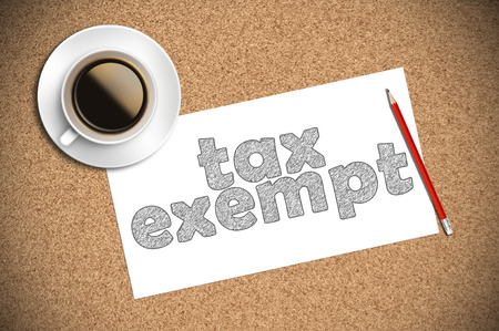 exempt: coffee and pencil sketch tax exempt on paper. Stock Photo