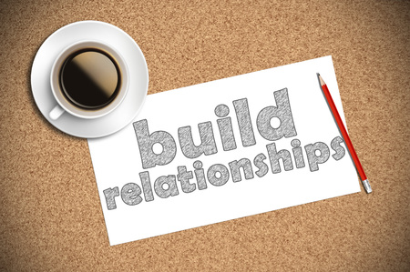 trustful: coffee and pencil sketch build relationships on paper. Stock Photo