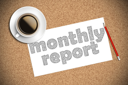 coffee and pencil sketch monthly report on paper. Stock Photo