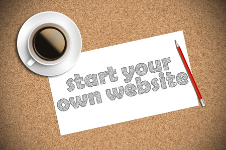 owning: coffee and pencil sketch start your own website on paper. Stock Photo