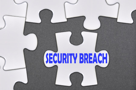 breach: The white jigsaw puzzle written word security breach.