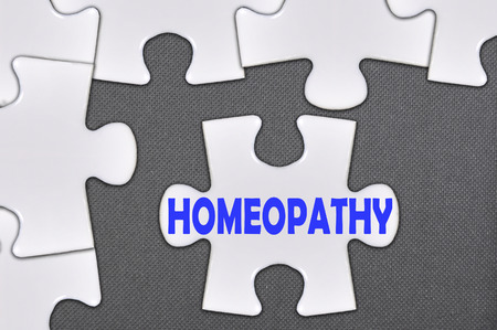 diagnosed: The white jigsaw puzzle written word homeopathy. Stock Photo