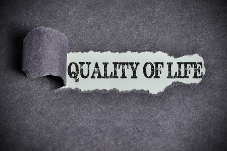 quality of life: quality of life word under torn black sugar paper.
